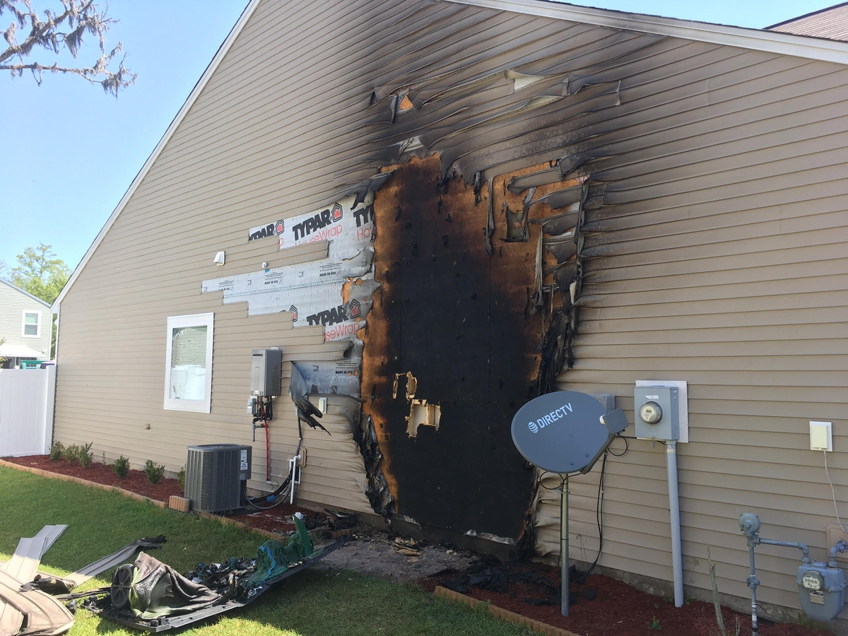 A fire that began in a waste container up against a home spread to the side of the residence in Shadow Moss.