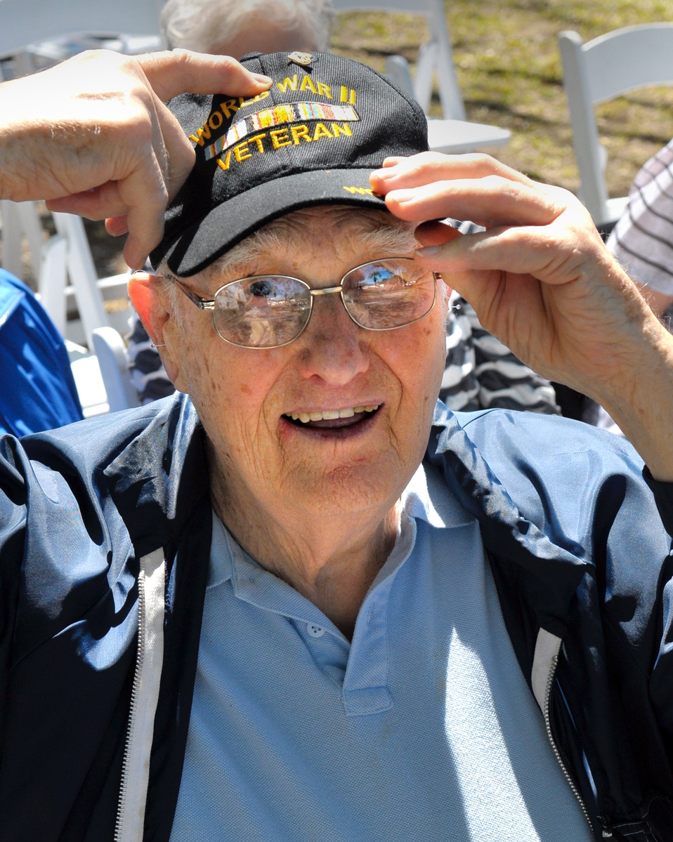Russell Smith, 93, shows off the veteran's pin on his cap. Smith served in the U.S. Navy during WWII.