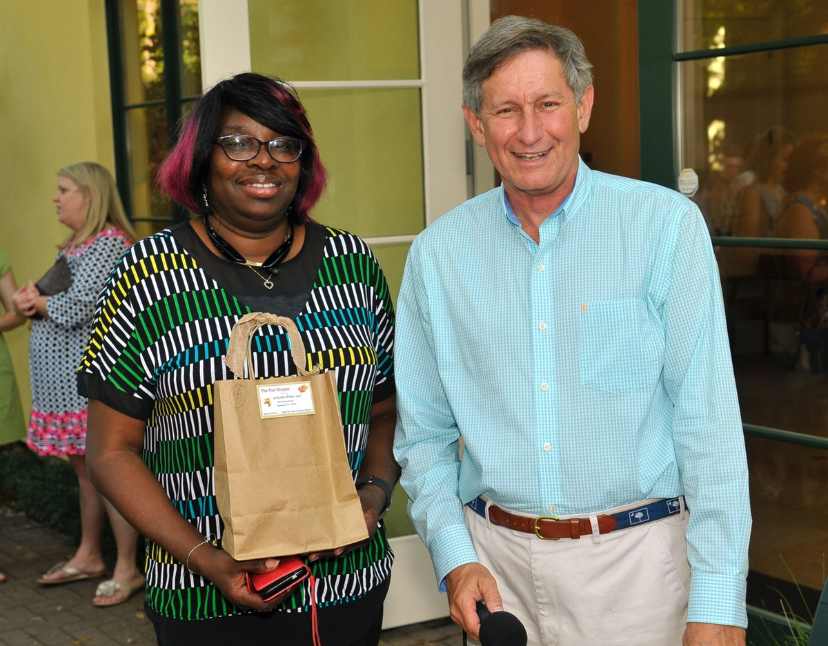 Inez Miller, picks up her Nut Shoppe door prize from Bob Guinn of The Island News.