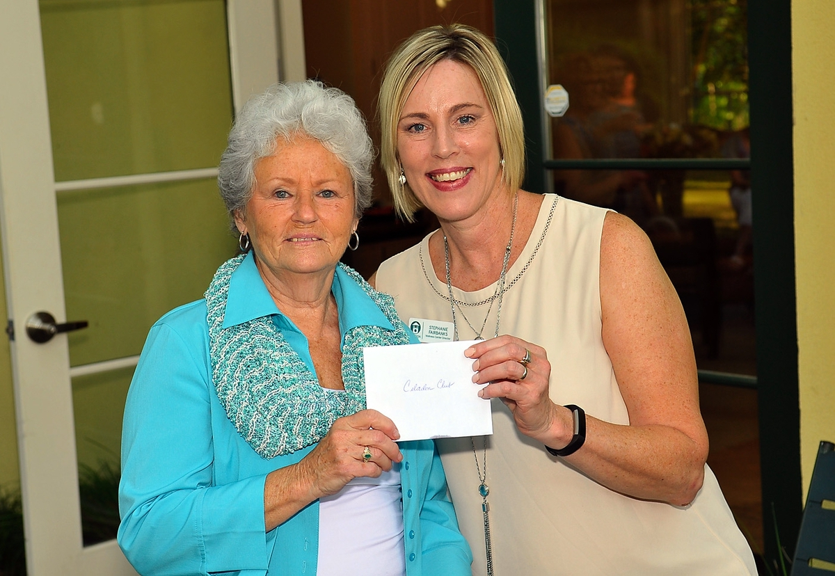Claudia Thomas, left, won a temporary membership to Celadon presented by Stephanie Fairbanks.