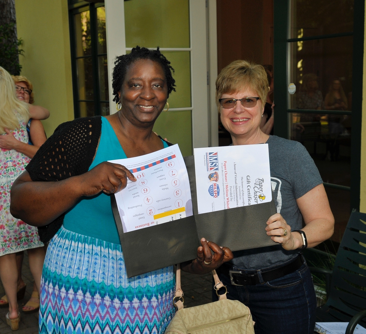 "Priscilla Butler, left, won a ""virtual assistant"" from Melissa St. Clair of Paper Chasers."