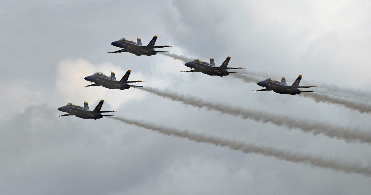 The U.S. Navy's Blue Angles fly a tight formation under threatening skies Saturday afternoon at Marine Corps Air Station Beaufort.