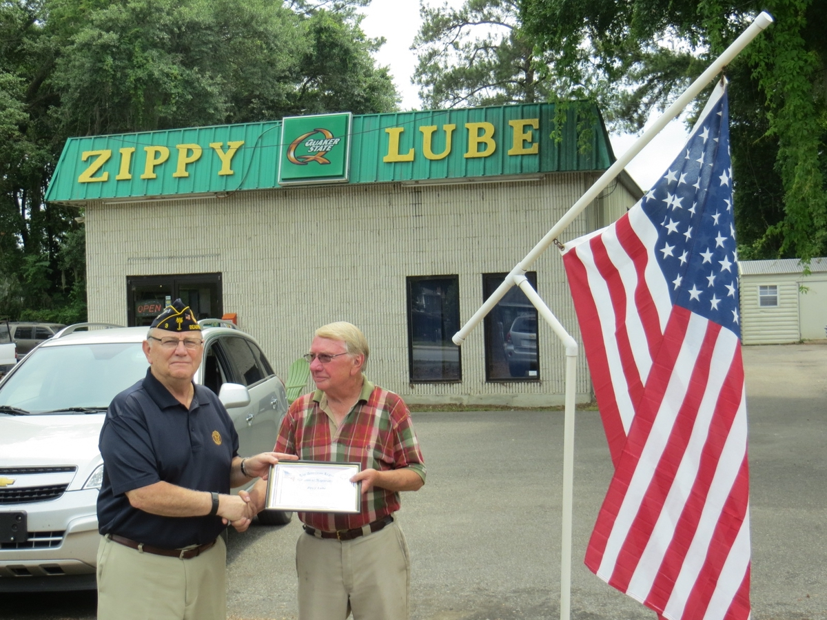 American Legion Beaufort Post 9 is striving to promote both patriotism and businesses in the Beaufort area by calling attention to those that proudly display the U.S. flag at their location. Post 9 presents those enterprises with a framed certificate thanking them. Above, Post 9 Commander Chuck Lurey presents Larry Kizer of Zippy Lube with his certificate.