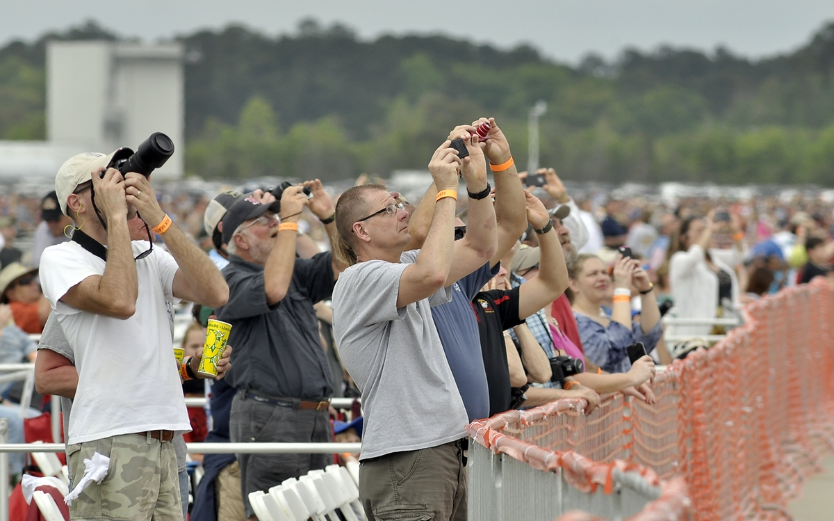 The audience watches as flyers perform feats of derring-do at the 2015 MCAS Beaufort Air Show.