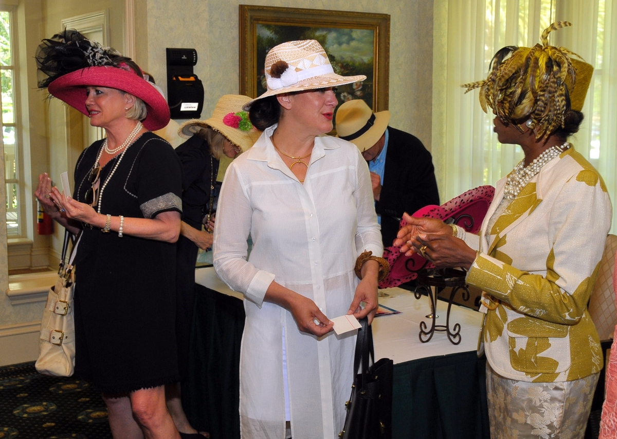 Members of the Beaufort History Museum show off their differing styles of hats during the spring tea.