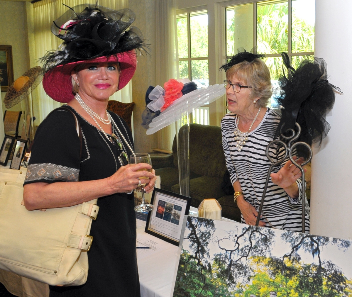 Terri Goldenberg, left, chats with Jane Sidwell at the silent auction table.