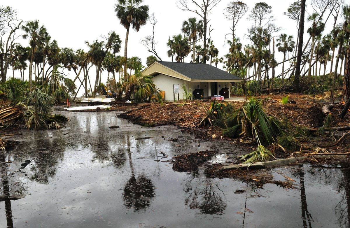 Storm debris, dead trees and standing water still plague efforts to rebuild Hunting Island State Park. A few pine trees still standing in the background have already been marked to be cut down as soon as work crews can make their way back in.