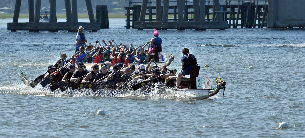Dragonboat racers from Gilbert Law Firm accelerate away from the competition to win Race #5 June 24 on the Beaufort River.