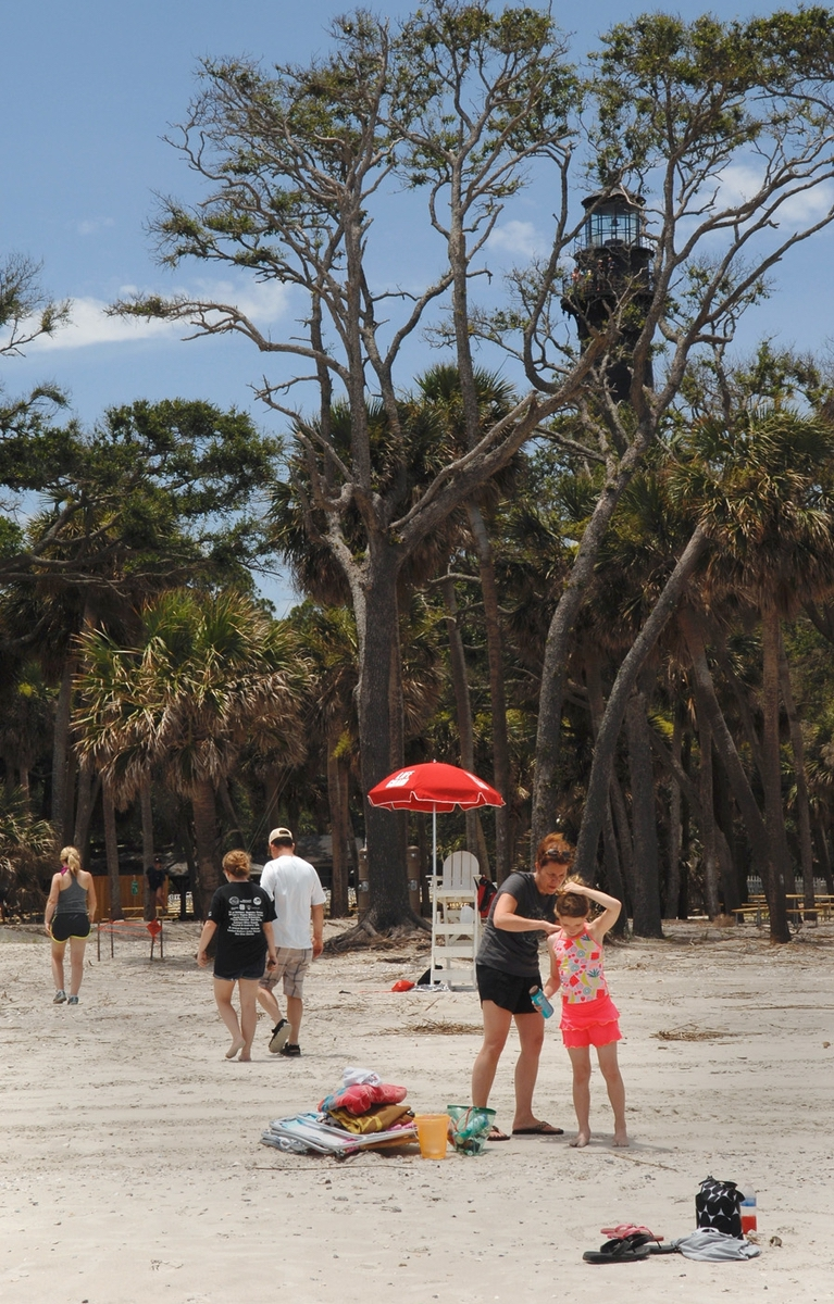 The Spangler family gets ready for a day at the beach June 2 near the lighthouse at Hunting Island State Park. It was the first day the popular park has been open to visitors since Hurricane Matthew blew through in October 2016. The first thing that is noticeable is the lack of pine trees at the surf line. Gone too are the sand dunes.