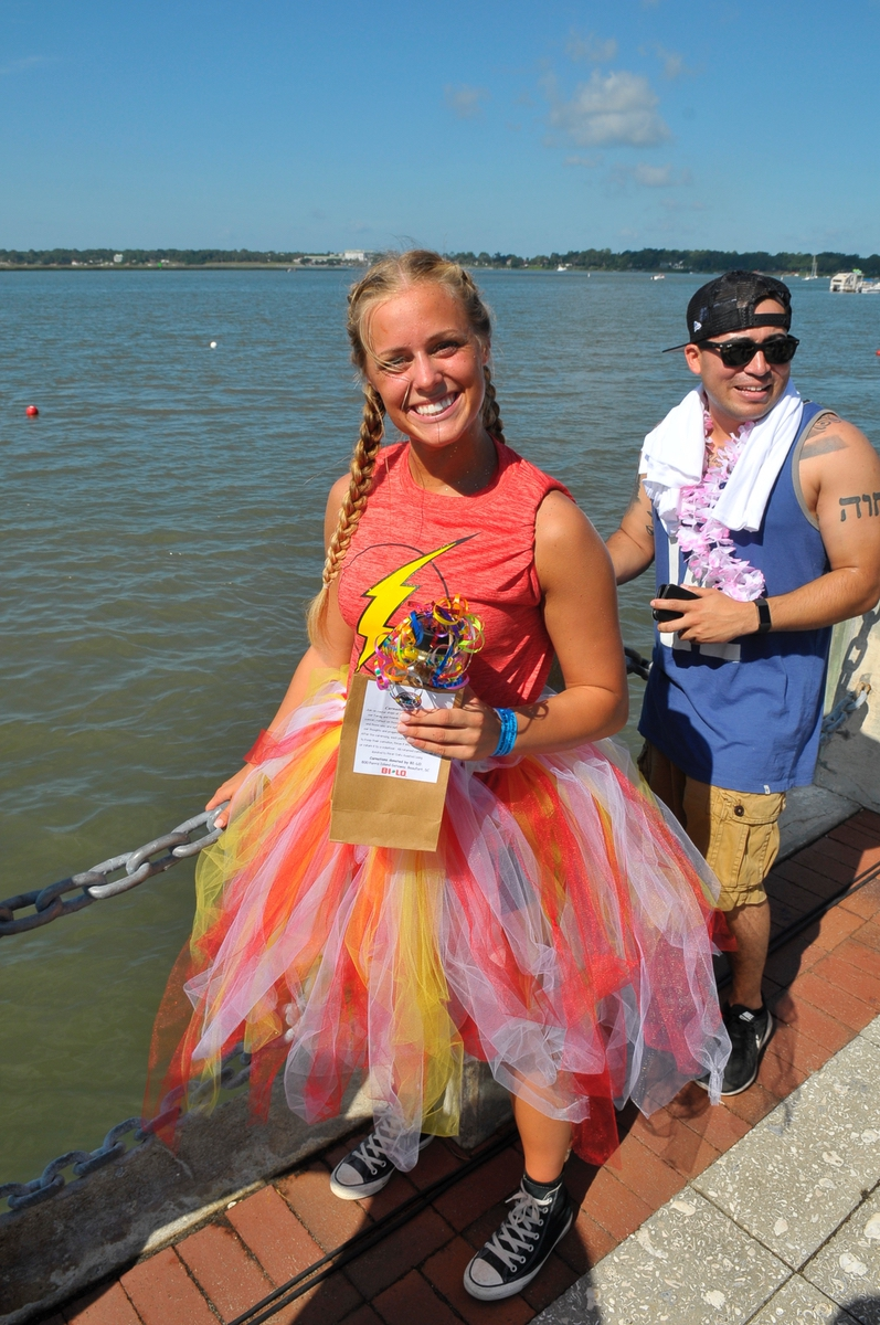 """Boat drummers, like Kinsey Olson for """"Thunder Struck,"""" also went around and gathered donations from spectators at Henry C. Chambers Waterfront Park."""