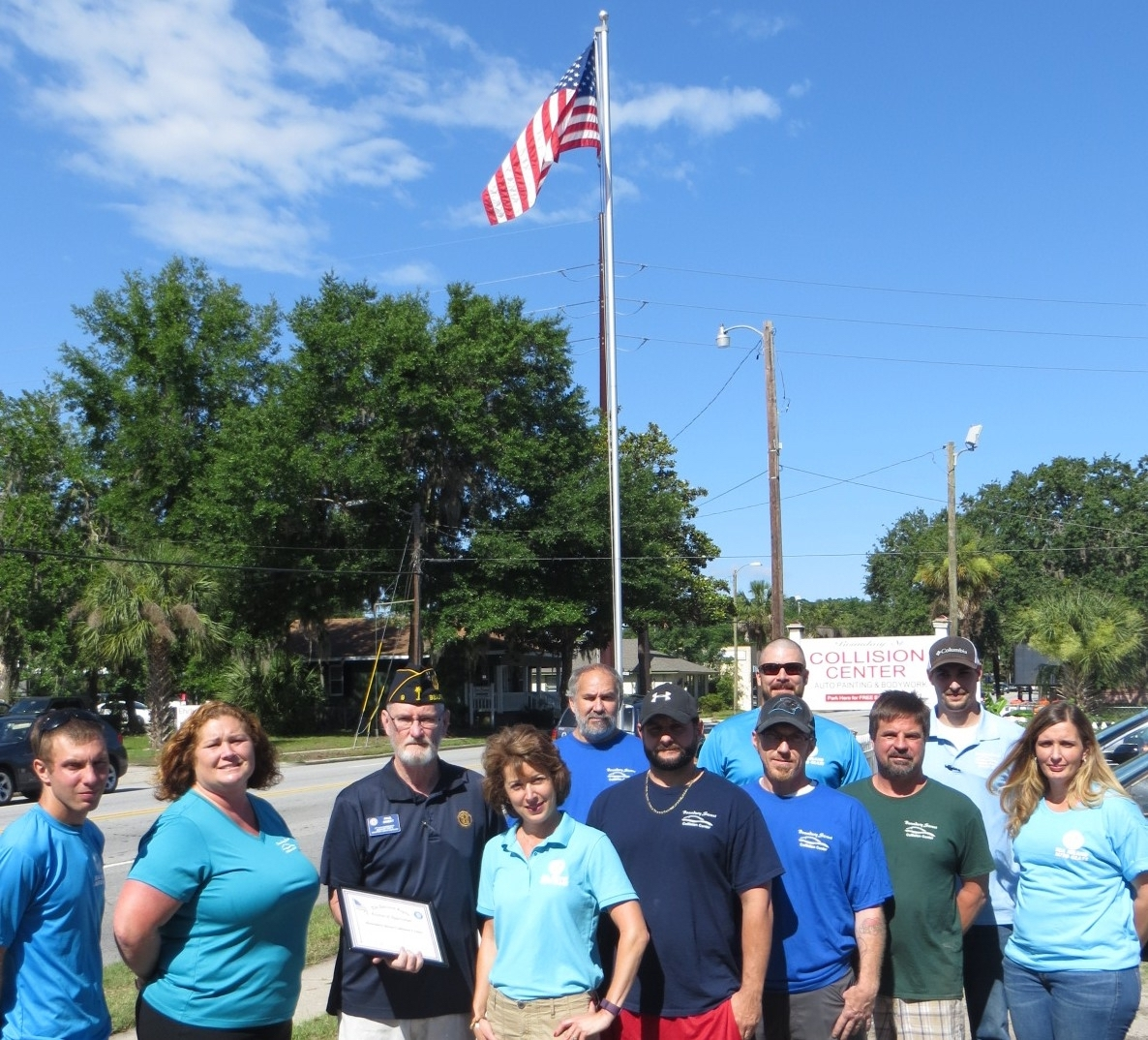 American Legion Beaufort Post 9 is striving to promote both patriotism and businesses in the Beaufort area by calling attention to those that proudly display the U.S. flag at their location. Post 9 presents those enterprises with a framed certificate thanking them. Here, Post 9 Vice Commander Paul Sweet presents Boundary Street Collision & Sea Island Auto Glass owner Lisa Melvin and staff with a certificate for displaying the nation's flag.