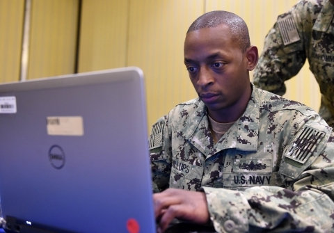 U.S. Navy Reserve Operations Specialist 1st Class Patrick Billups, a Beaufort, South Carolina native, works providing logistics support during Tradewinds 2017. Billups helped arrange personnel, drivers, and translators in conjunction with partner nations. Military and civilians from over 20 countries are participating in this year's exercise in Barbados, and Trinidad and Tobago, which runs from June 6-17, 2017. Tradewinds is a joint, combined exercise conducted in conjunction with partner nations to enhance the collective abilities of defense forces and constabularies to counter transnational organized crime, and to conduct humanitarian and disaster relief operations. (U.S. Navy photo by Mass Communication Specialist 1st Class Melissa K. Russell/Released)
