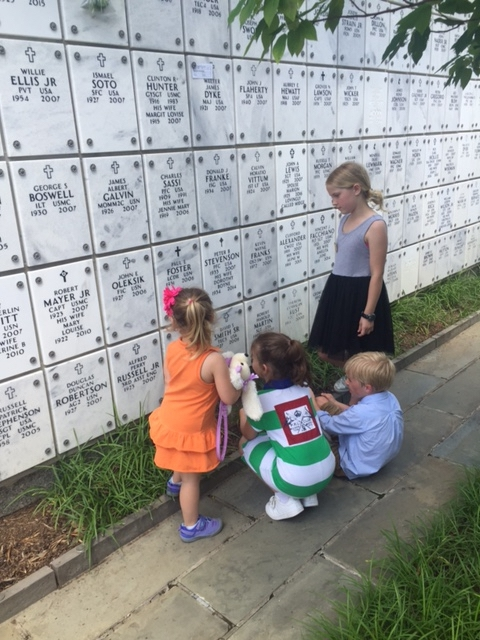 Lee Scott's grandchildren look at the plaques on the Columbarium at Arlington National Cemetery. Photo by Lee Scott.