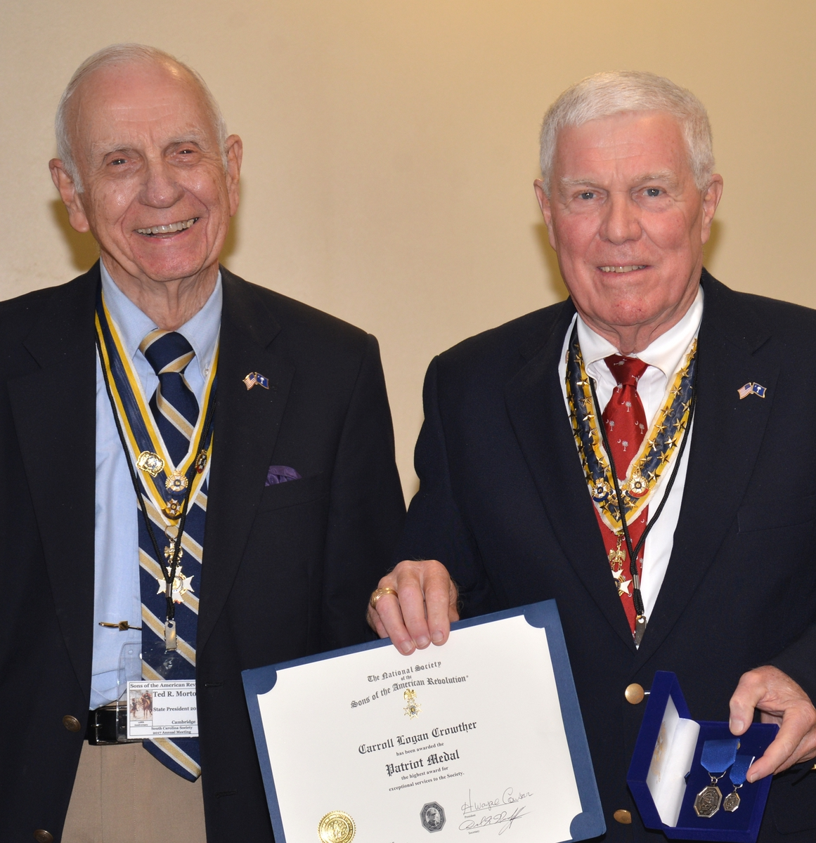 Carroll Crowther, right, holds his Patriot Medal Award. Standing with him is past SC Society President Ted Morton.