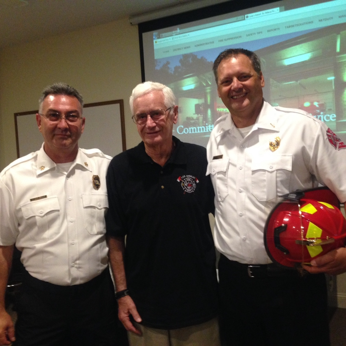 Scott Sampson, right, of the Lady's Island St. Helena Fire District, was recently promoted from senior firefighter to lieutenant. Sampson is accompanied by Chief Bruce Kline, left, and his father, Johnny Sampson, who retired in 1988 after 30 years service with the Los Angeles Fire Department.