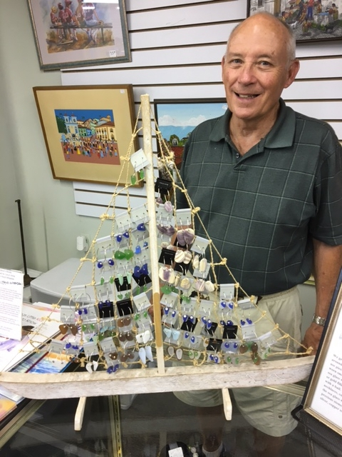 The 2or3 Treasure House is marking its first anniversary with a weeklong, storewide sale, which will include jewelry shown here by manager Gordon Mabie. Photo provided.