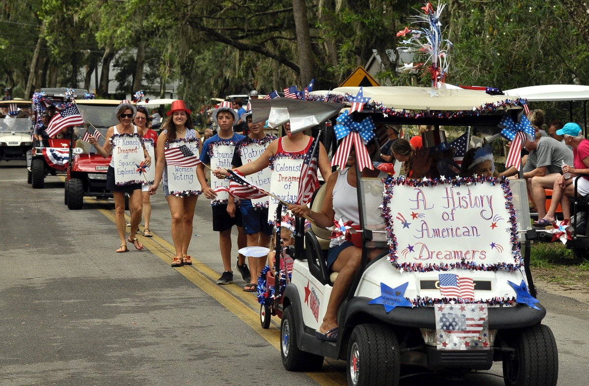 Some participants walked in the annual Lands End Fourth of July parade. Here, some wear placards commenting about different times throughout American history.