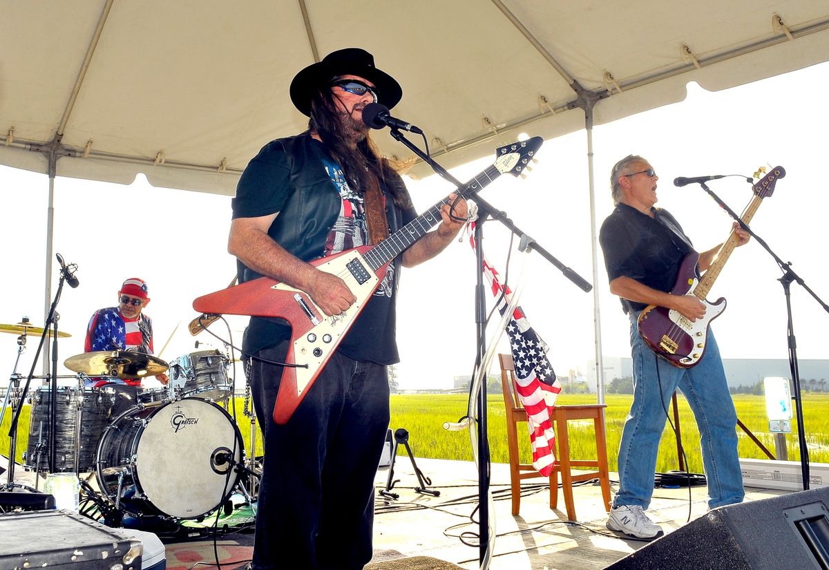 Helping to keep the party going, the High Velocity Band from Bloomingdale, Ga., played their brand of southern rock music at The Sands Beach in Port Royal. Pictured here are, from left, drummer Glenn Smith, lead guitarist Ray Tomasina and bass player Ronnie Able. Not shown is keyboardist Doug Lanier.