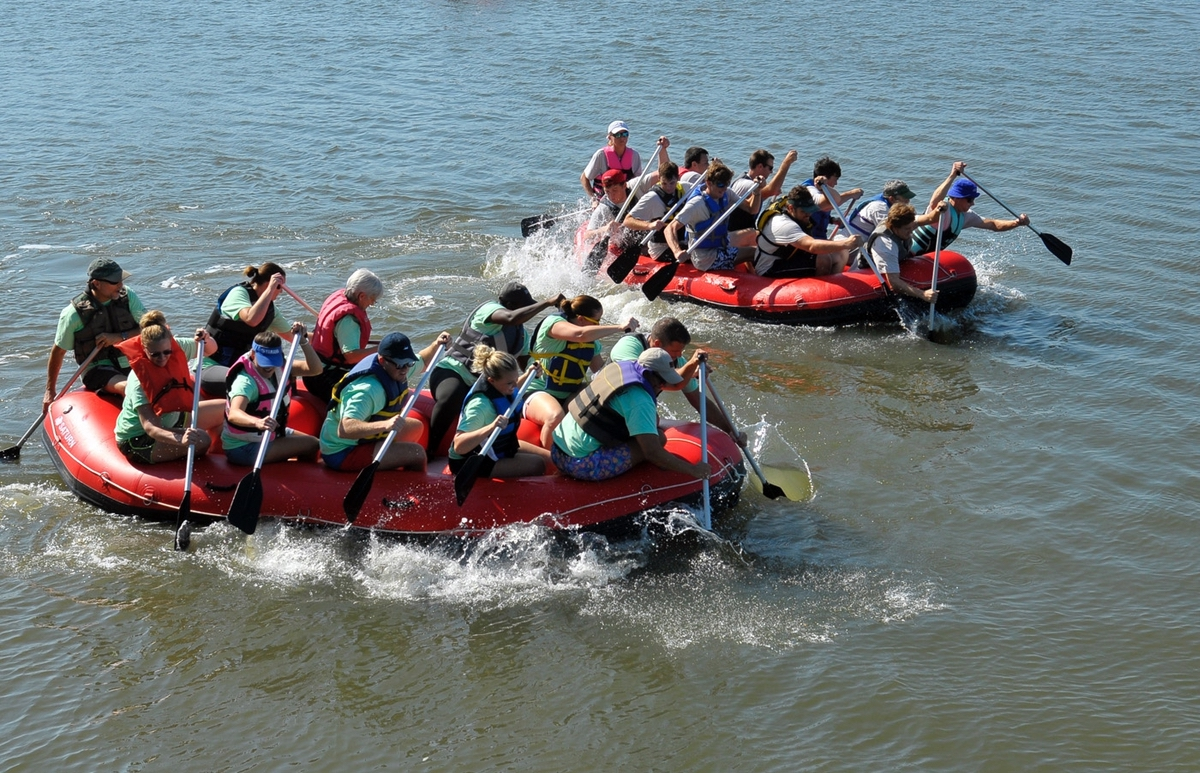 The annual Raft Races in the Beaufort River near the sea wall of Henry C. Chambers Waterfront Park is always a crowd favorite. Here team Goin' Postal, top, starts to move out as team Complete Car Care of Beaufort digs in as well. Goin' Postal won the heat. Photos by Bob Sofaly.