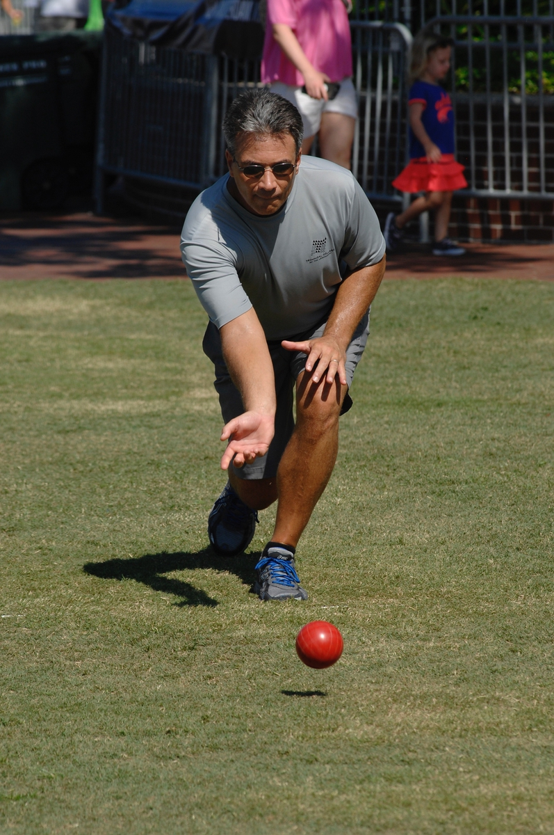 Greg Maniocourt launches his bocce ball during a close match July 15 during the annual Bocce Ball Tournament at Henry C. Chambers Waterfront Park. Maniocourt and teammate Nick Hunt won the tournament. It was their sixth victory in the Water Festival Bocce Ball Tournament.