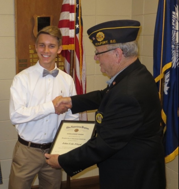 Post 9 Commander Chuck Lurey presents John Cole Floyd, a 2017 graduate of the Community Bible Church Christian Academy, with his educational scholarship. Floyd will be attending North Greenville University.