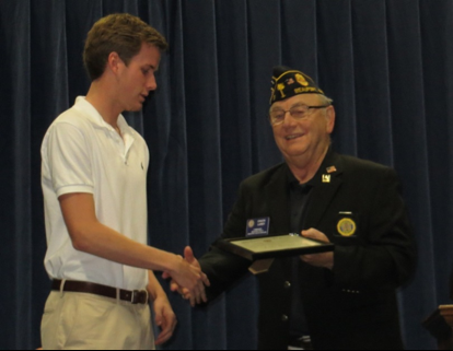 Post 9 Commander Chuck Lurey presents Luke Harper, a 2017 graduate of Beaufort Academy, with his educational scholarship. Harper will be attending USC.