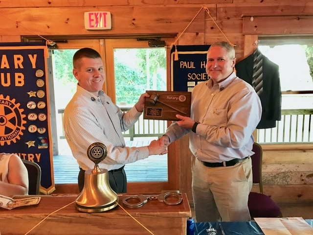 Scott Klumb presents a thank you plaque and gavel to outgoing Club President Alan Beach. Photo provided.