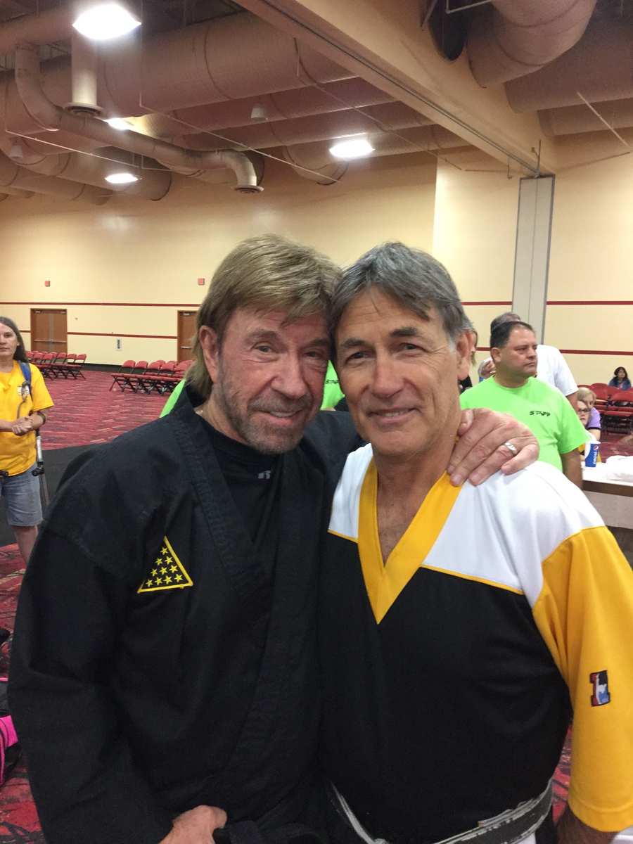 Chuck Elias, head instructor at Club Karate, is shown here with actor Chuck Norris. Photo provided.