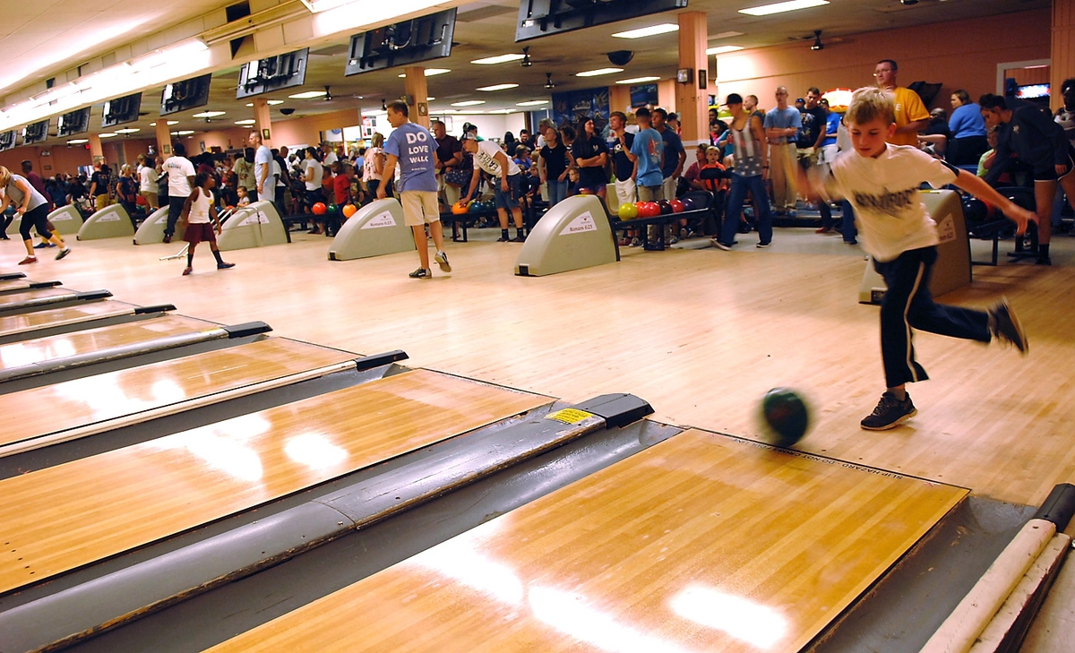 Bryce Young, 8, looks like a pro bowler as he releases his ball during the inaugural Racial Harmony Bowling Event on Aug. 23. The event, according to Pastor Randy Roberts of Love House Ministries, was a direct result of racist graffiti spray painted on an exterior wall of their bowling alley on Aug. 19.