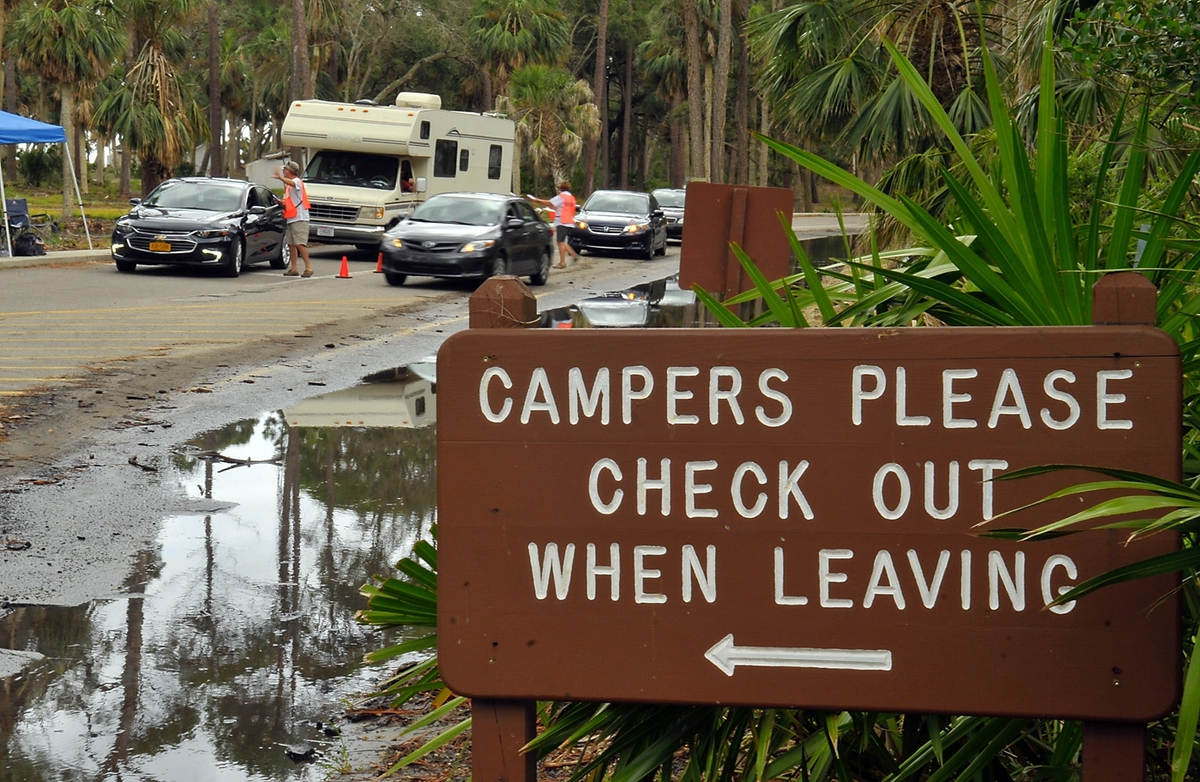 The Hunting Island State Park Campground officially opened on Aug. 4. Here, campers check in with volunteers Jim and Pam Holcombe for directions and check-in information. The popular campground has been closed since October 2016 because of Hurricane Matthew.