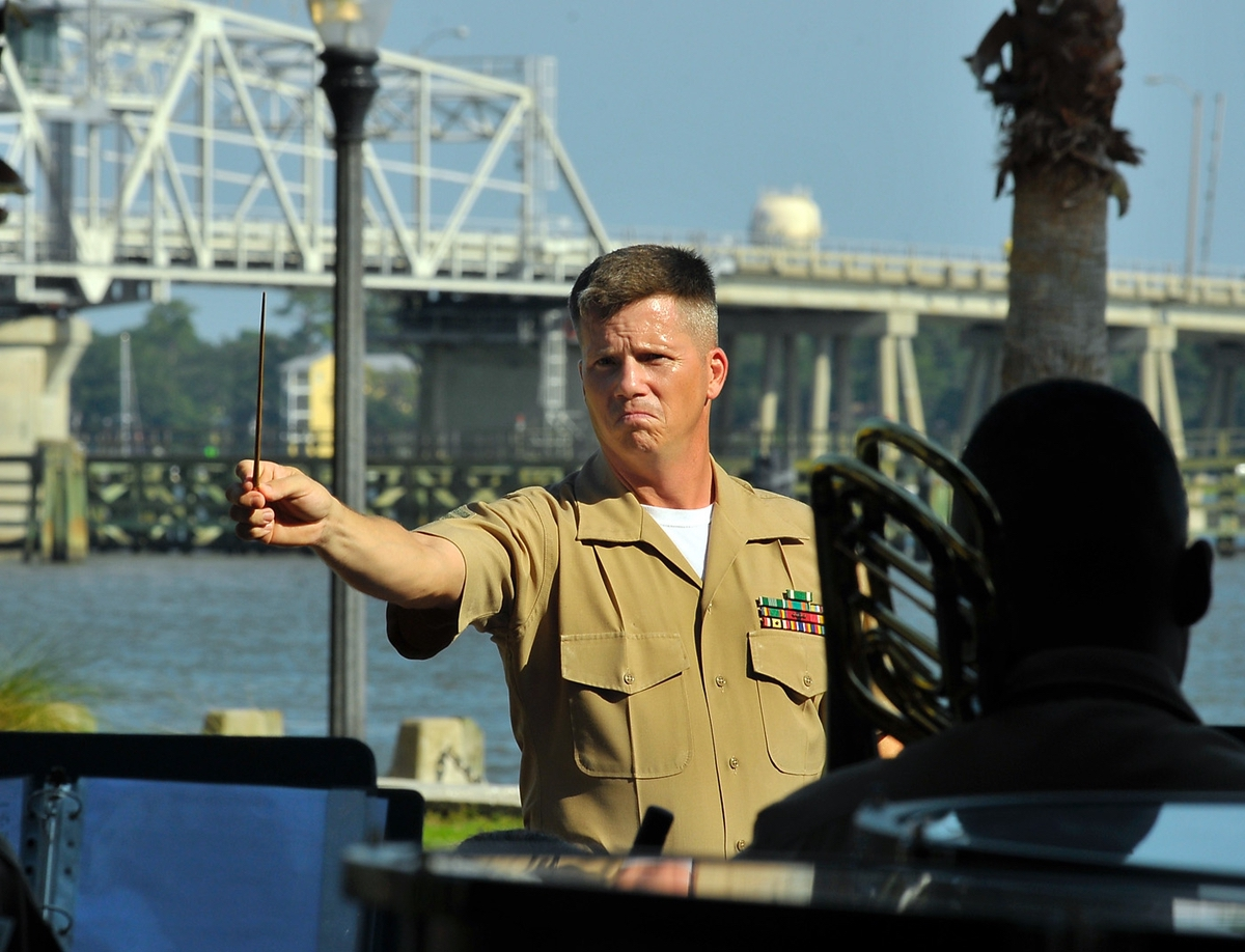 Gunnery Sgt. Stephen Davis, enlisted conductor of the Parris Island Marine Band, leads his Marines during the free concert at the fourth annual Tribute to Vietnam Veterans at Henry C. Chambers Waterfront Park.