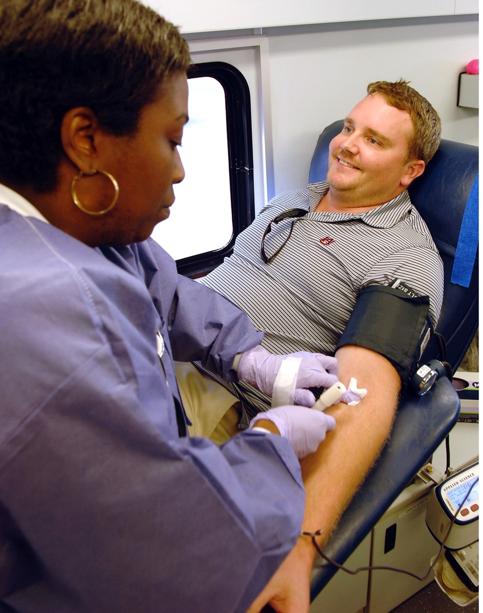 Angel Hayes, left, a phlebotomist with OneBlood, takes out the needle from the arm of Rett Bullard of Beaufort during a blood drive for the flood victims in Houston. Hayes said OneBlood collects blood for local hospitals but is also sending some to hospitals in Houston.