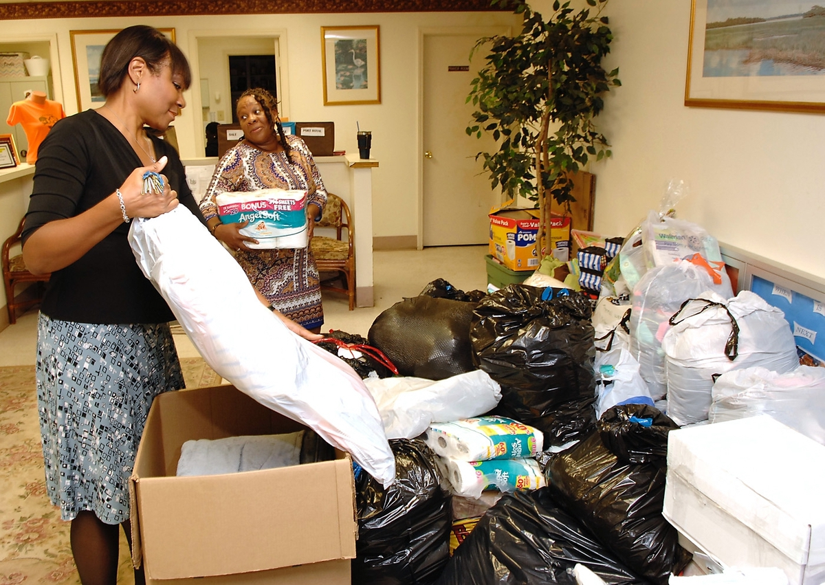 Teresa Roberts, left, and Portia Siler sort through some of the clothing and toilet articles donated for flood victims in Houston. Roberts said they opted not to work through any national organization. They instead planned on renting a tractor-trailer and driving to Houston. The donations will then be distributed by members of their organization.