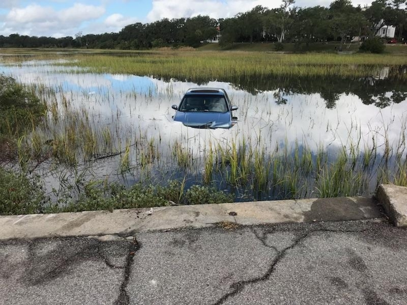 A car ended up in the marsh at 1010 Bay St. How it happened is unclear. Photo provided.