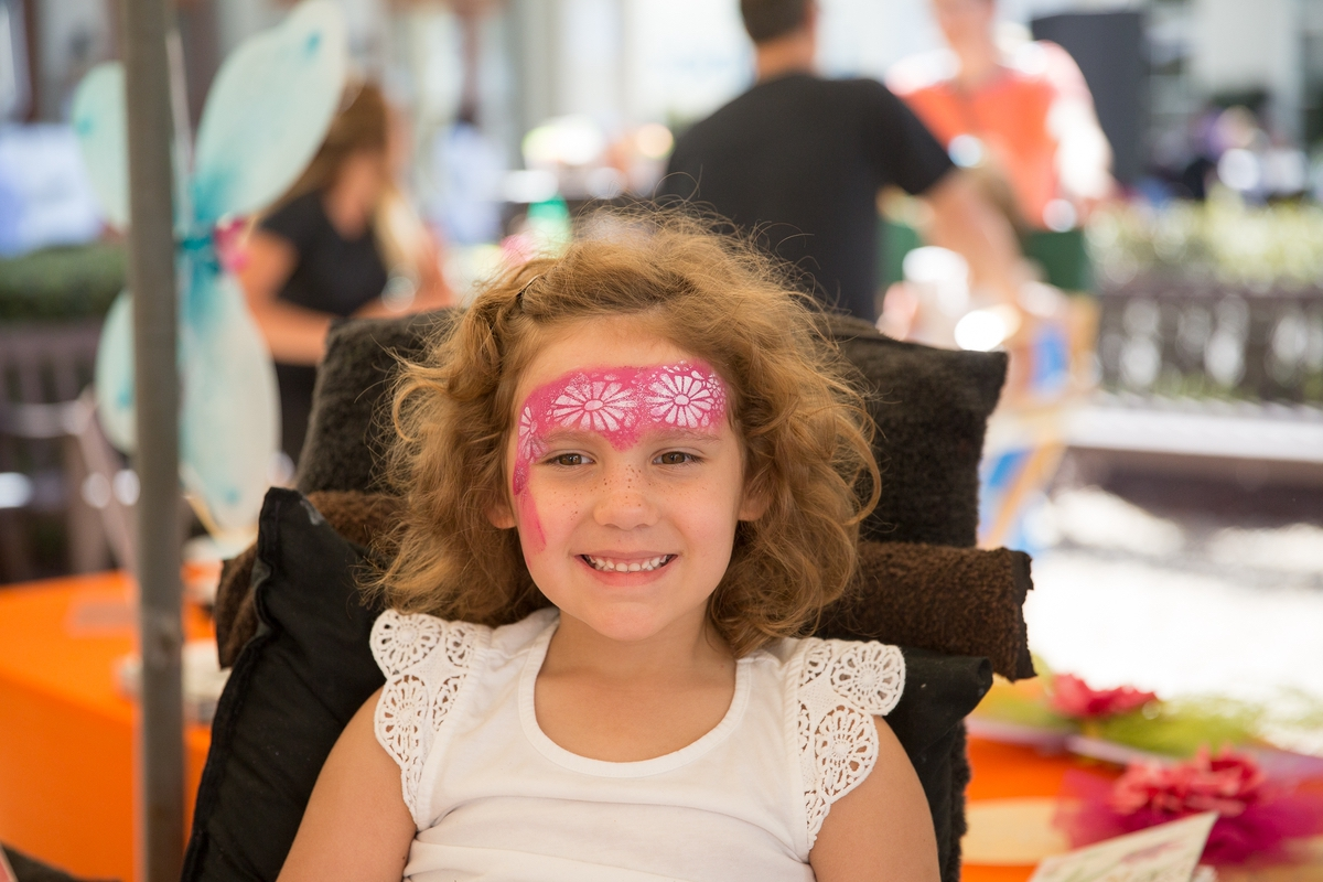 A little girl gets her face painted at the 9th Annual Habersham Harvest Festival. Photo by SK Signs & Designs.