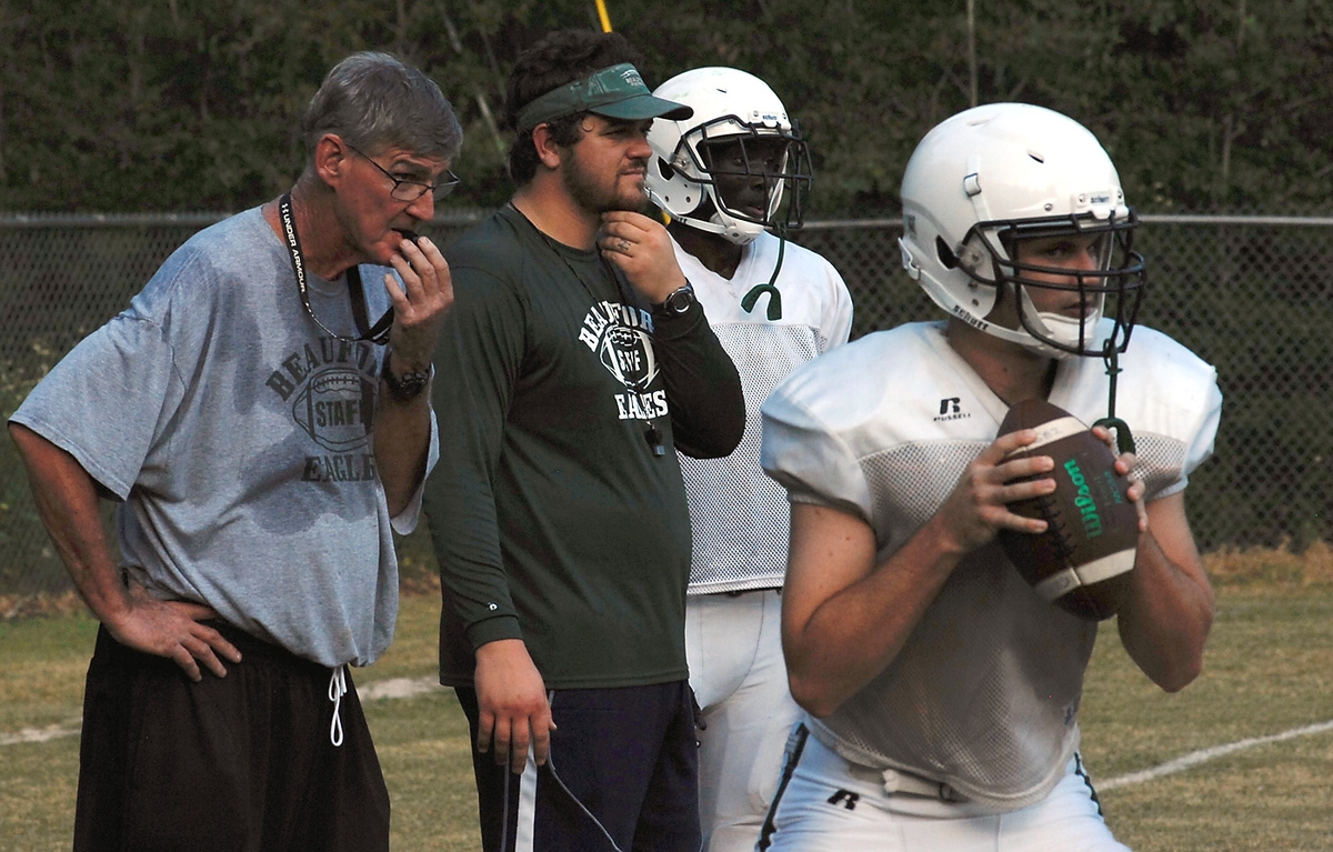Beaufort High School's head football coach Mark Clifford, left, watches his team practice on Sept. 26. The Eagles have a perfect 5-0 start to their 2017 season.