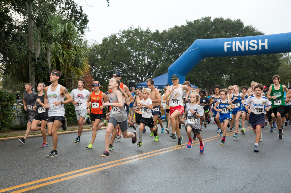 Runners and walkers take off at the start of the Run Forrest Run 5K.