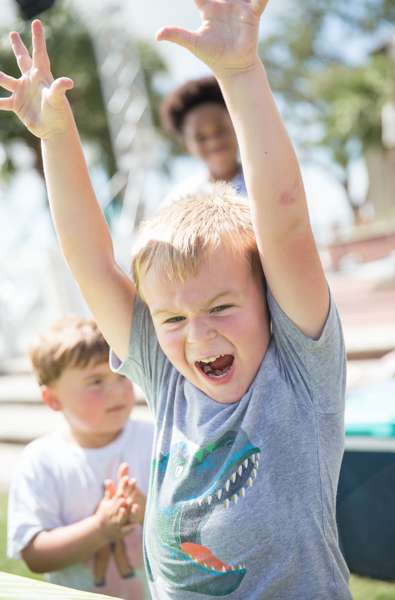 A little boy named Flynn reacts to winning the Shrimp Peeling Contest in the 3-6 age group at the Beaufort Shrimp Festival.