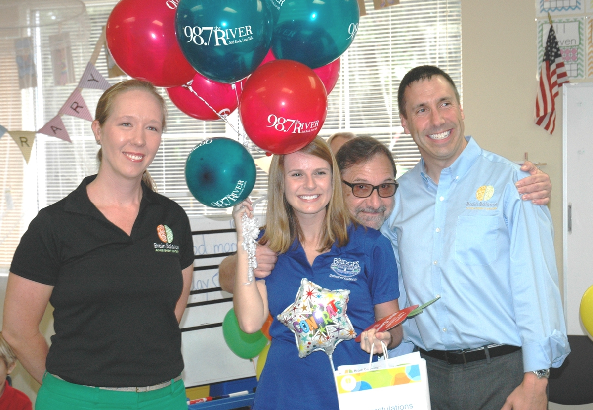 Grace Converse is shown here with Mark Robertson and Brain Balance reps. Photo provided.