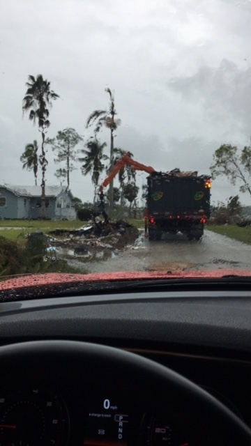 """The guys with the big black trucks and trailers and claw arms are independent contractors who are known by the insiders as """"storm chasers."""" Because of the destruction wrought by Hurricane Harvey there are fewer of them to go around to gather up the debris left behind by Irma and Nate. Accordingly, the clean-ups for those hurricanes will be slower than usual. Photo provided."""