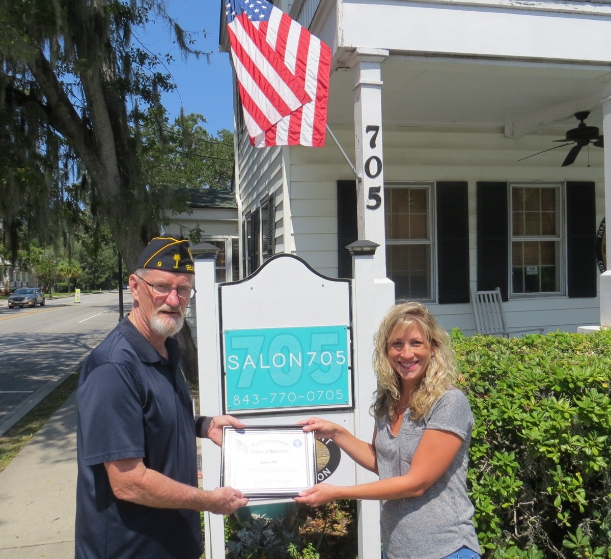 American Legion Beaufort Post 9 is striving to promote both patriotism and businesses in the Beaufort area by calling attention to those that proudly display the U.S. flag at their location. Post 9 presents those enterprises with a framed certificate thanking them. Here, Post 9 Vice Commander Paul Sweet presents Salon 705 owner Jennifer Whetsel a certificate of appreciation for displaying the flag.