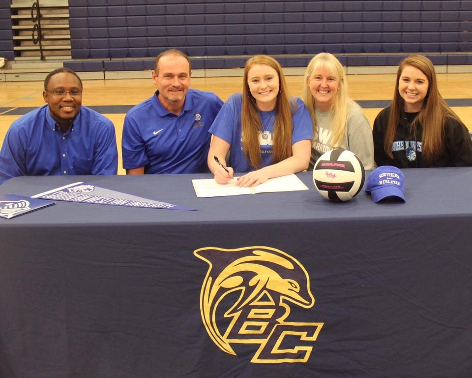 Battery Creek High School senior Mia DeBardelaben, center, has signed to play volleyball for Southern Wesleyan University. Photo courtesy of Battery Creek High School.