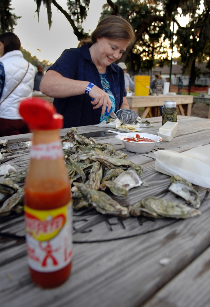 Paige McKenzie spent her birthday on Nov. 4 attending her first oyster roast. Here, she timidly cuts into an oyster during the event.