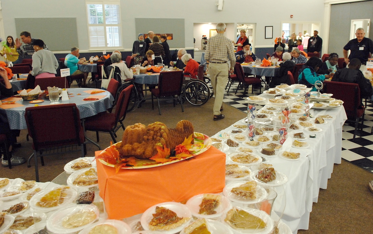 Tables of desserts of every description are pre-cut and ready to be consumed for those who still have room left after eating at the annual Thanksgiving Community Meal at St. Helena Episcopal Church.