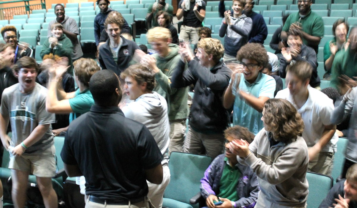 Beaufort High School football players react to the announcement that DeVonte Holloman is their new head coach. Photo provided.