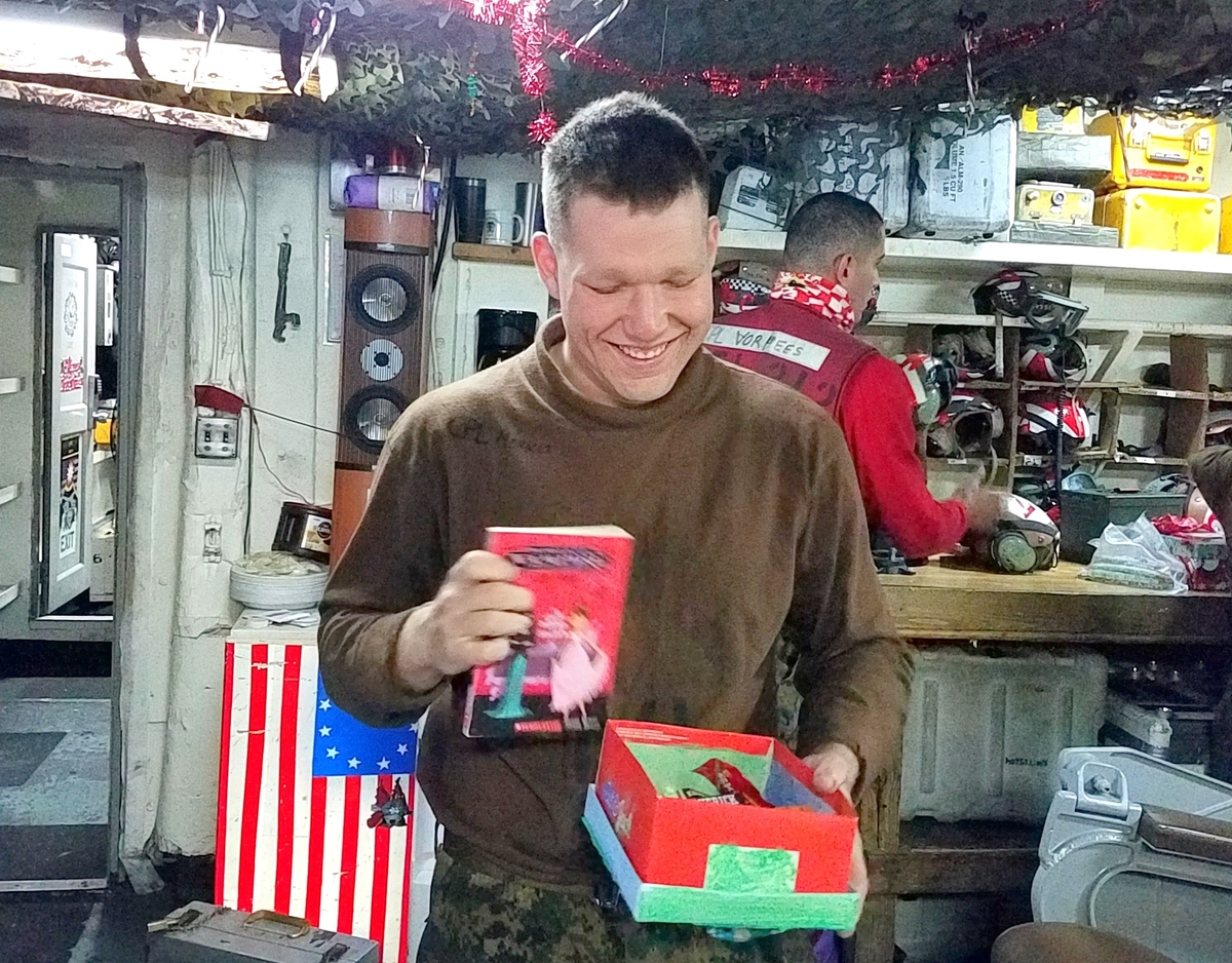 Nearly 200 Boxes of Cheer – decorated shoeboxes full of small gifts created by Beaufort County School District students – have been successfully delivered to Beaufort-based Marines deployed over the holidays on the carrier USS Theodore Roosevelt. Gift items were gathered by the students and holiday cards were created by middle school students, with individual Marines' gifts packaged in shoeboxes decorated by elementary school students. More than $800 in shipping costs were paid with donations from school district employees. Photos provided.