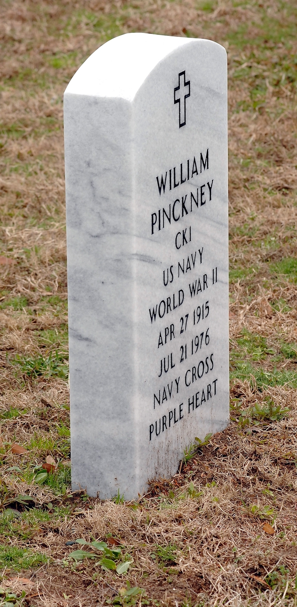 The new headstone for WWII Navy veteran William Pinckney now reads Purple Heart and Navy Cross. Pinckney was awarded the nation's second highest medal for valor for his unsurpassed bravery while rescuing his shipmates after a Japanese bomb exploded in the ammunition magazine in which Pinckney, a ship's cook, was assigned as his battle station aboard the aircraft carrier U.S.S. Enterprise during the Battle of Santa Cruz in October, 1942.